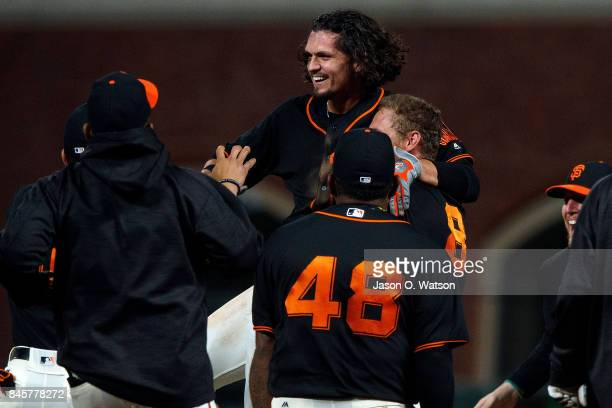 Jarrett Parker of the San Francisco Giants is congratulated by teammates after hitting a walk off single in the tenth inning against the Arizona...