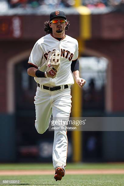 Jarrett Parker of the San Francisco Giants returns to the dugout during the fourth inning against the San Diego Padres at ATT Park on May 25 2016 in...