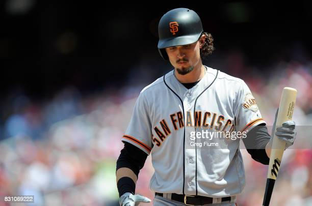 Jarrett Parker of the San Francisco Giants walks to the dugout after striking out in the second inning against the Washington Nationals during Game 1...