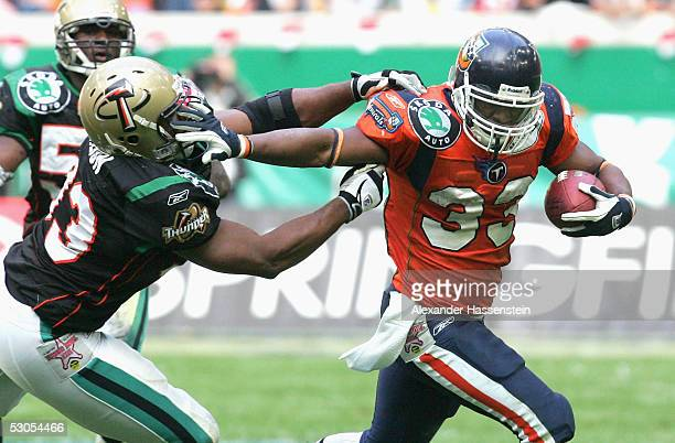 Jarrett Payton of Amsterdam in action with Daryl Dixon of Berlin during the Yello Strom World Bowl XIII between the Berlin Thunder and the Amsterdam...