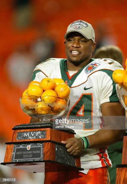 Jarrett Payton of the Miami Hurricanes displays his 2004 Orange Bowl MVP trophy after Miami defeated the Florida State Seminoles 1614 to win the Fed...