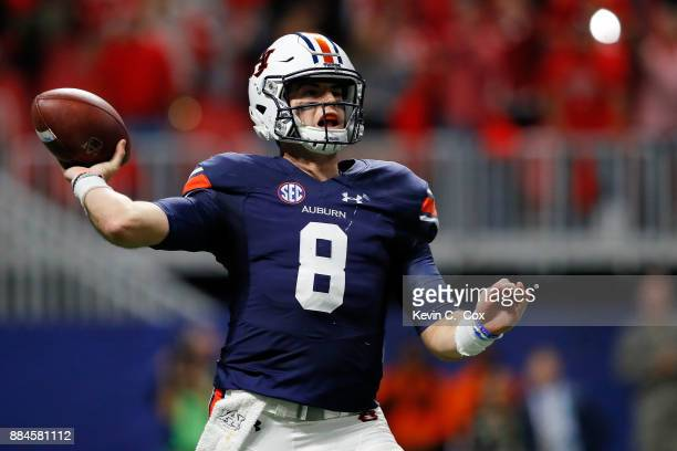 Jarrett Stidham of the Auburn Tigers drops back to pass during the first half against the Georgia Bulldogs in the SEC Championship at MercedesBenz...