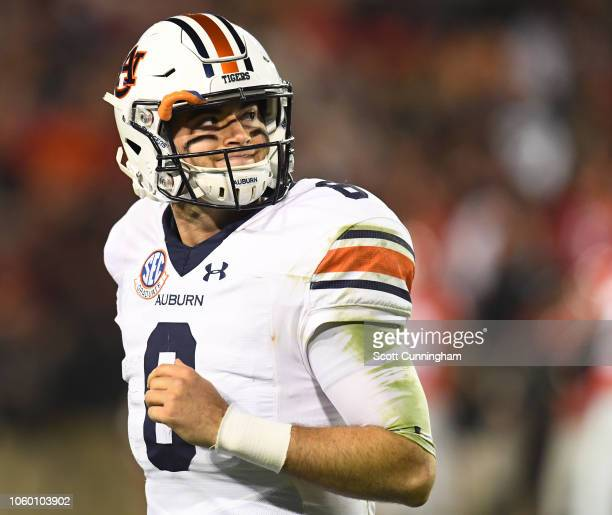 Jarrett Stidham of the Auburn Tigers heads off the field after failing to make a first down against the Georgia Bulldogs on November 10 2018 at...