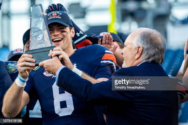 Jarrett Stidham of the Auburn Tigers is awarded the Most Valuable Player award after defeating the Purdue Boilermakers at Nissan Stadium on December...