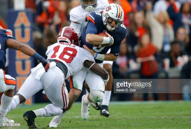 Jarrett Stidham of the Auburn Tigers is tackled by Dylan Moses of the Alabama Crimson Tide during the second quarter of the game at Jordan Hare...