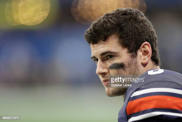 Jarrett Stidham of the Auburn Tigers looks on in the first half against the UCF Knights during the ChickfilA Peach Bowl at MercedesBenz Stadium on...