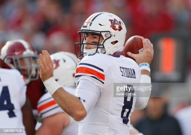 Jarrett Stidham of the Auburn Tigers looks to pass against the Alabama Crimson Tide at BryantDenny Stadium on November 24 2018 in Tuscaloosa Alabama