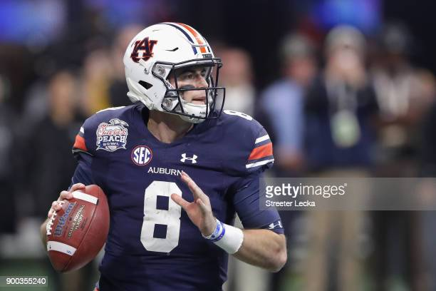Jarrett Stidham of the Auburn Tigers looks to pass in the second half against the UCF Knights during the ChickfilA Peach Bowl at MercedesBenz Stadium...