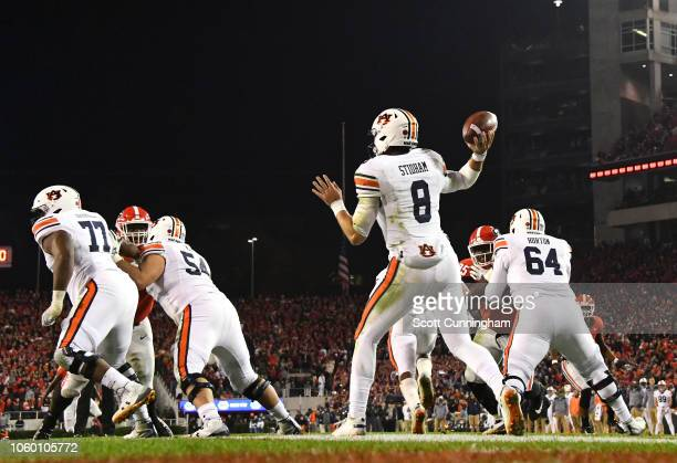 Jarrett Stidham of the Auburn Tigers passes out of his end zone against the Georgia Bulldogs on November 10 2018 at Sanford Stadium in Athens Georgia