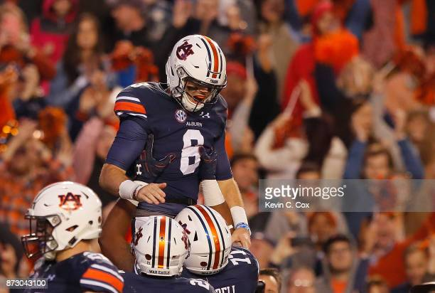 Jarrett Stidham of the Auburn Tigers reacts after rushing for a touchdown against the Georgia Bulldogs at Jordan Hare Stadium on November 11 2017 in...