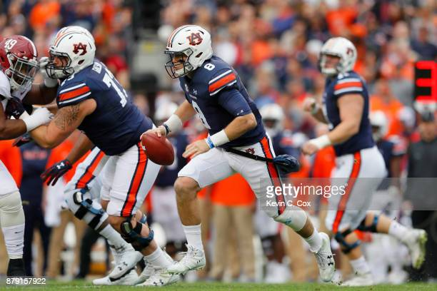 Jarrett Stidham of the Auburn Tigers rushes the ball during the first quarter against the Alabama Crimson Tide at Jordan Hare Stadium on November 25...