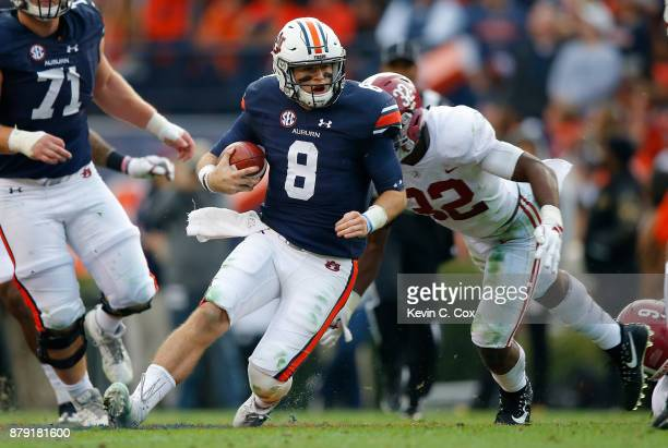 Jarrett Stidham of the Auburn Tigers rushes the ball during the second quarter against the Alabama Crimson Tide at Jordan Hare Stadium on November 25...