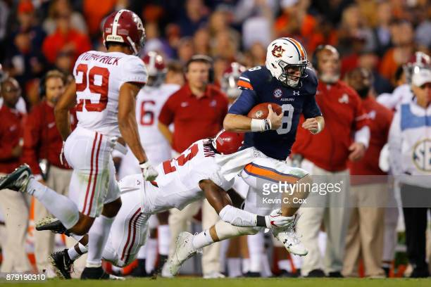 Jarrett Stidham of the Auburn Tigers rushes the ball during the third quarter against the Alabama Crimson Tide at Jordan Hare Stadium on November 25...