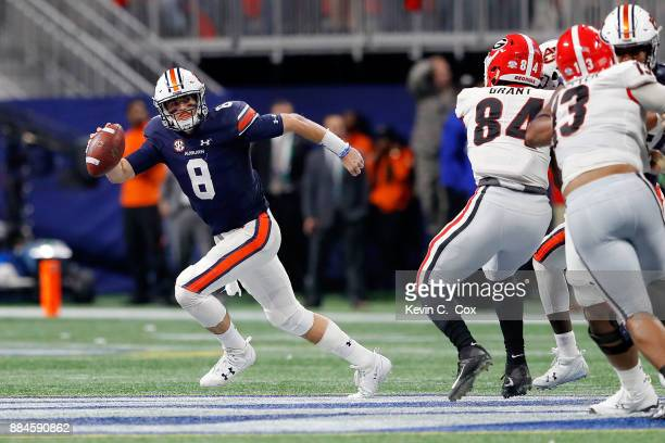 Jarrett Stidham of the Auburn Tigers scrambles on a pass play during the second half against the Georgia Bulldogs in the SEC Championship at...