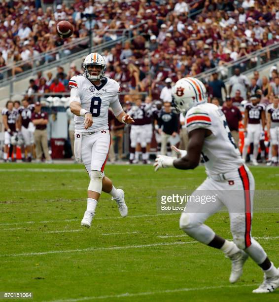 Jarrett Stidham of the Auburn Tigers throws a 2 yard pass to Kerryon Johnson for a touchdown in the second quarter against the Texas AM Aggies at...