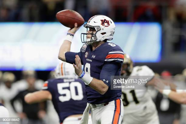 Jarrett Stidham of the Auburn Tigers throws a pass in the first half against the UCF Knights during the ChickfilA Peach Bowl at MercedesBenz Stadium...