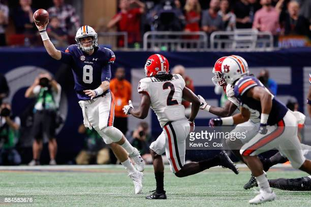 Jarrett Stidham of the Auburn Tigers throws on the run during the second half against the Georgia Bulldogs in the SEC Championship at MercedesBenz...