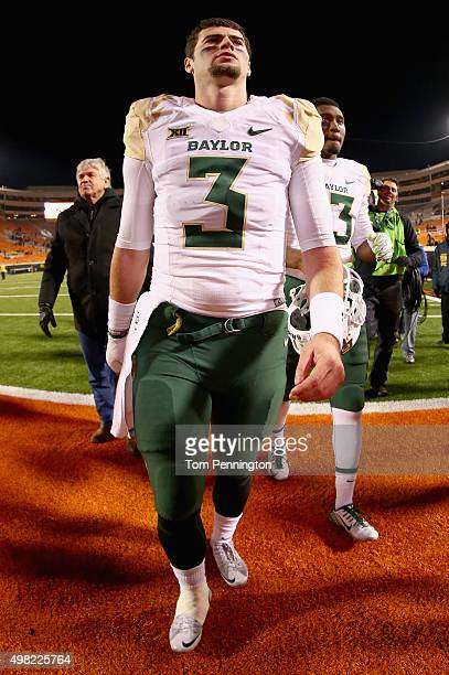 Jarrett Stidham of the Baylor Bears and Chris Johnson of the Baylor Bears walk offsides the field after the Baylor Bears beat the Oklahoma State...
