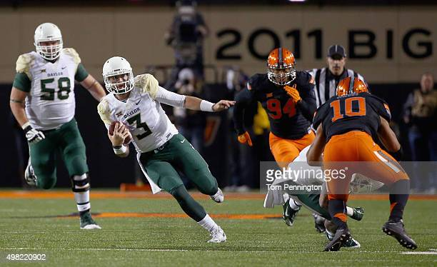 Jarrett Stidham of the Baylor Bears scrambles with the ball against the Oklahoma State Cowboys in the second quarter at Boone Pickens Stadium on...