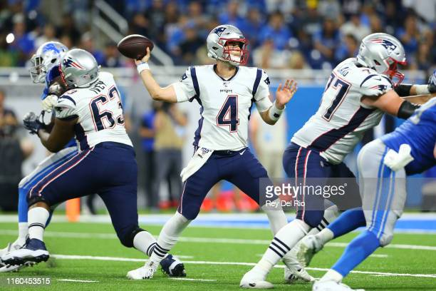 Jarrett Stidham of the New England Patriots drops back to pass during the second quarter of the game against the Detroit Lions during the preseason...