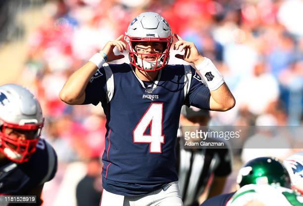 Jarrett Stidham of the New England Patriots gestures against the New York Jets at Gillette Stadium on September 22 2019 in Foxborough Massachusetts