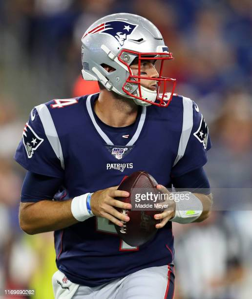 Jarrett Stidham of the New England Patriots looks for a pass during the preseason game between the Carolina Panthers and the New England Patriots at...