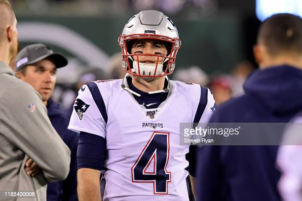 Jarrett Stidham of the New England Patriots looks on against the New York Jets at MetLife Stadium on October 21 2019 in East Rutherford New Jersey
