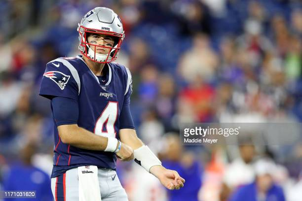 Jarrett Stidham of the New England Patriots looks on during the preseason game between the New York Giants and the New England Patriots at Gillette...