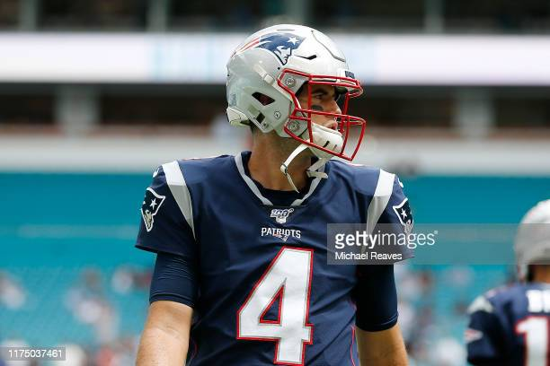 Jarrett Stidham of the New England Patriots looks on prior to the game between the Miami Dolphins and the New England Patriots at Hard Rock Stadium...