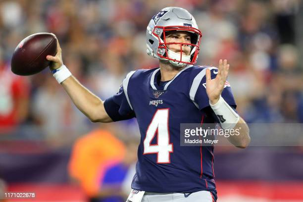 Jarrett Stidham of the New England Patriots makes a pass during the preseason game between the New York Giants and the New England Patriots at...
