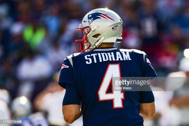 Jarrett Stidham of the New England Patriots prepares to throw during the fourth quarter of a game against the New York Jets at Gillette Stadium on...