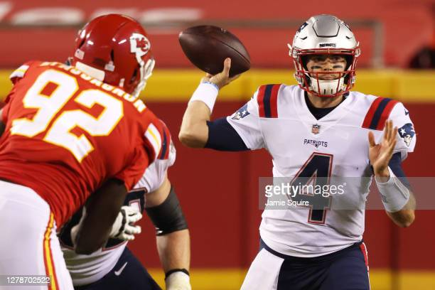 Jarrett Stidham of the New England Patriots throws a pass against the Kansas City Chiefs during the fourth quarter at Arrowhead Stadium on October 05...