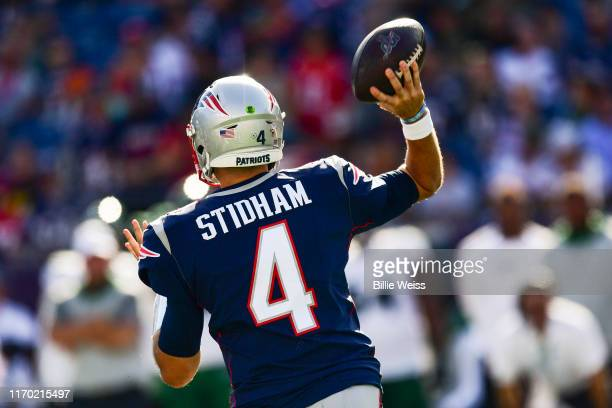 Jarrett Stidham of the New England Patriots throws during the fourth quarter of a game against the New York Jets at Gillette Stadium on September 22...