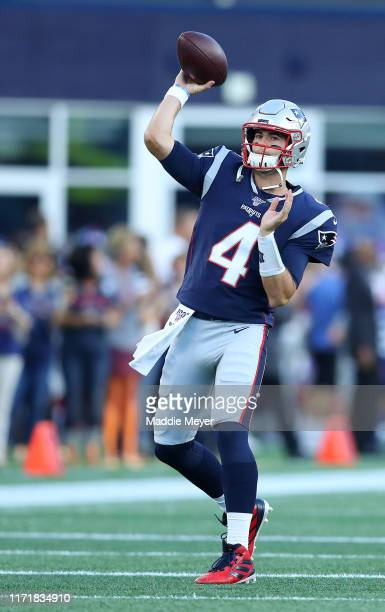 Jarrett Stidham of the New England Patriots warms up before the preseason game between the New York Giants and the New England Patriots at Gillette...