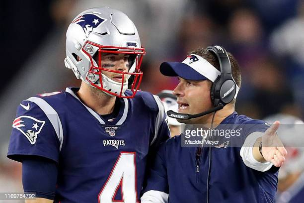 Jarrett Stidham talks with Offensive Coordinator Josh McDaniels during the preseason game between the Carolina Panthers and the New England Patriots...