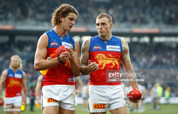 Jarrod Berry and Mitch Robinson of the Lions look dejected after a loss during the 2018 AFL round 19 match between the Geelong Cats and the Brisbane...