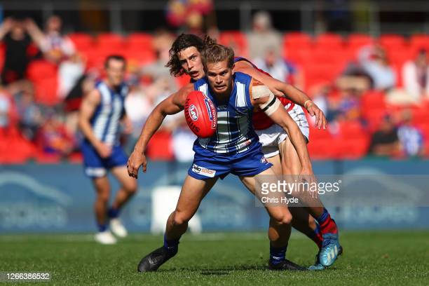 Jarrod Berry of the Lions and Jed Anderson of the Kangaroos compete for the ball during the round 12 AFL match between the North Melbourne Kangaroos...
