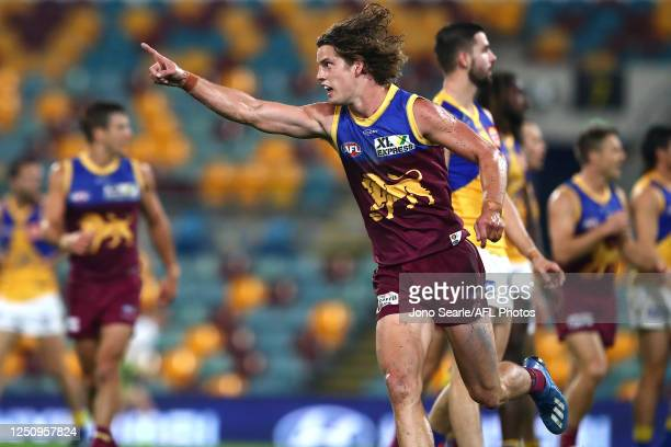 Jarrod Berry of the Lions celebrates a goal during the round 3 AFL match between the Brisbane Lions and the West Coast Eagles at Metricon Stadium on...