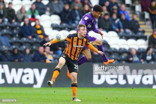 Jarrod Bowen of Hull City and Jamal Lewis of Norwich City battle for control of the ball during the Sky Bet Championship match between Hull City and...