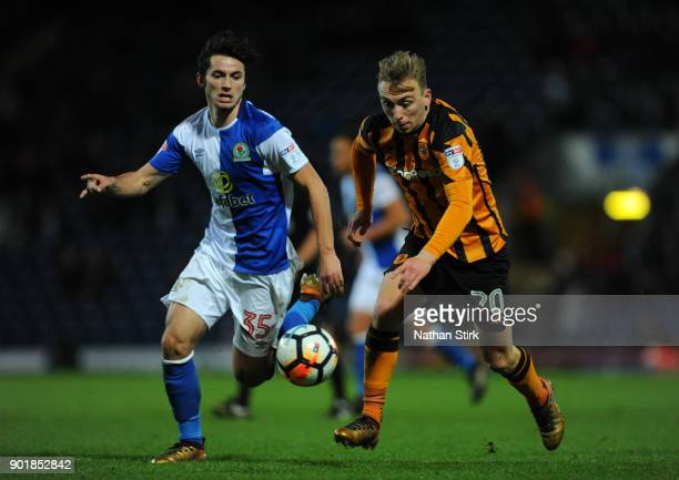 Jarrod Bowen of Hull City and Lewis Travis of Blackburn Rovers in action during The Emirates FA Cup Third Round match between Blackburn Rovers and...