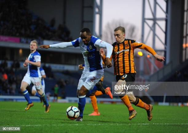 Jarrod Bowen of Hull City and Ryan Nyambe of Blackburn Rovers in action during The Emirates FA Cup Third Round match between Blackburn Rovers and...