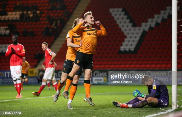 Jarrod Bowen of Hull City celebrates after scoring his team's first goal as Dillon Phillips of Charlton Athletic reacts during the Sky Bet...
