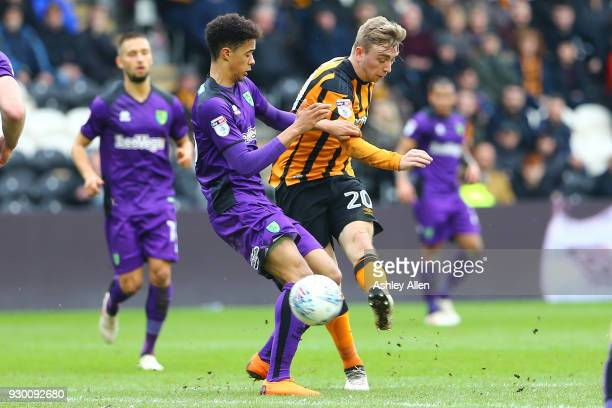 Jarrod Bowen of Hull City has a shot at goal as Jamal Lewis of Norwich City attempts to block it during the Sky Bet Championship match between Hull...