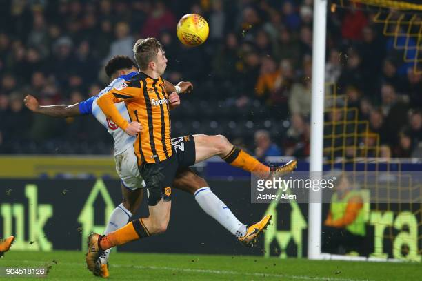 Jarrod Bowen of Hull City misses a chance at goal as Liam Moore of Reading challenges him during the Sky Bet Championship match between Hull City and...