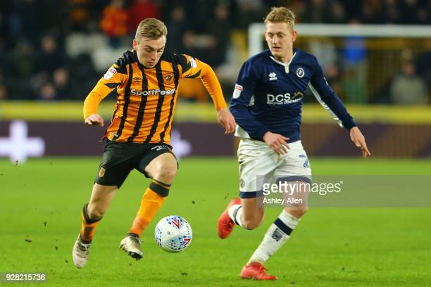 Jarrod Bowen of Hull City runs past George Saville of Millwall during the Sky Bet Championship match between Hull City and Millwall FC at KCOM...