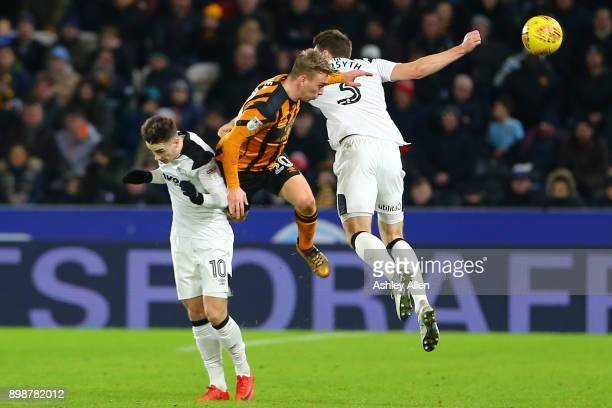 Jarrod Bowen of Hull City wins the ball from Derby County's Tom Lawrence and Craig Forsyth during the Sky Bet Championship match between Hull City...