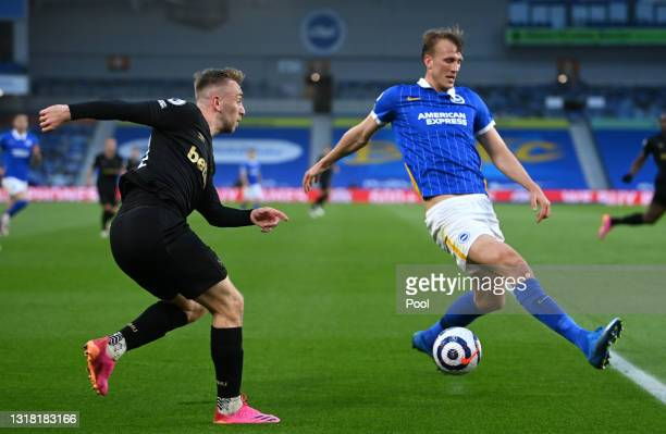 Jarrod Bowen of West Ham United and Dan Burn of Brighton and Hove Albion battle for possession during the Premier League match between Brighton &...