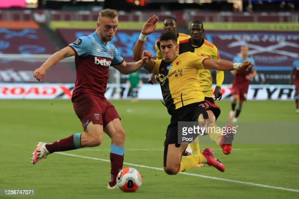 Jarrod Bowen of West Ham United battles for possession with Adam Masina of Watford during the Premier League match between West Ham United and...