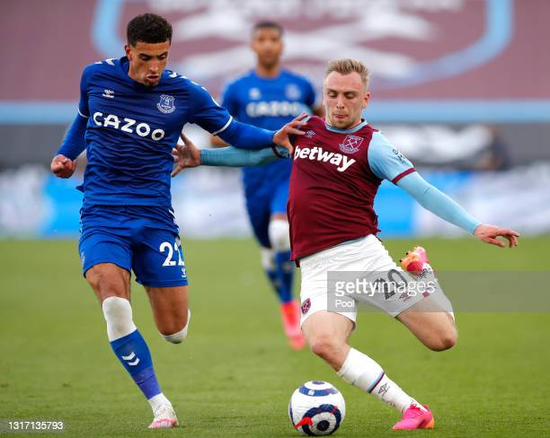 Jarrod Bowen of West Ham United battles for possession with Ben Godfrey of Everton during the Premier League match between West Ham United and...