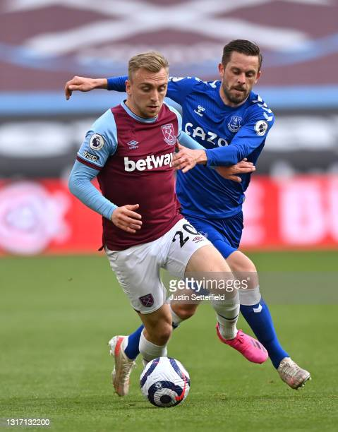 Jarrod Bowen of West Ham United battles for possession with Gylfi Sigurdsson of Everton during the Premier League match between West Ham United and...